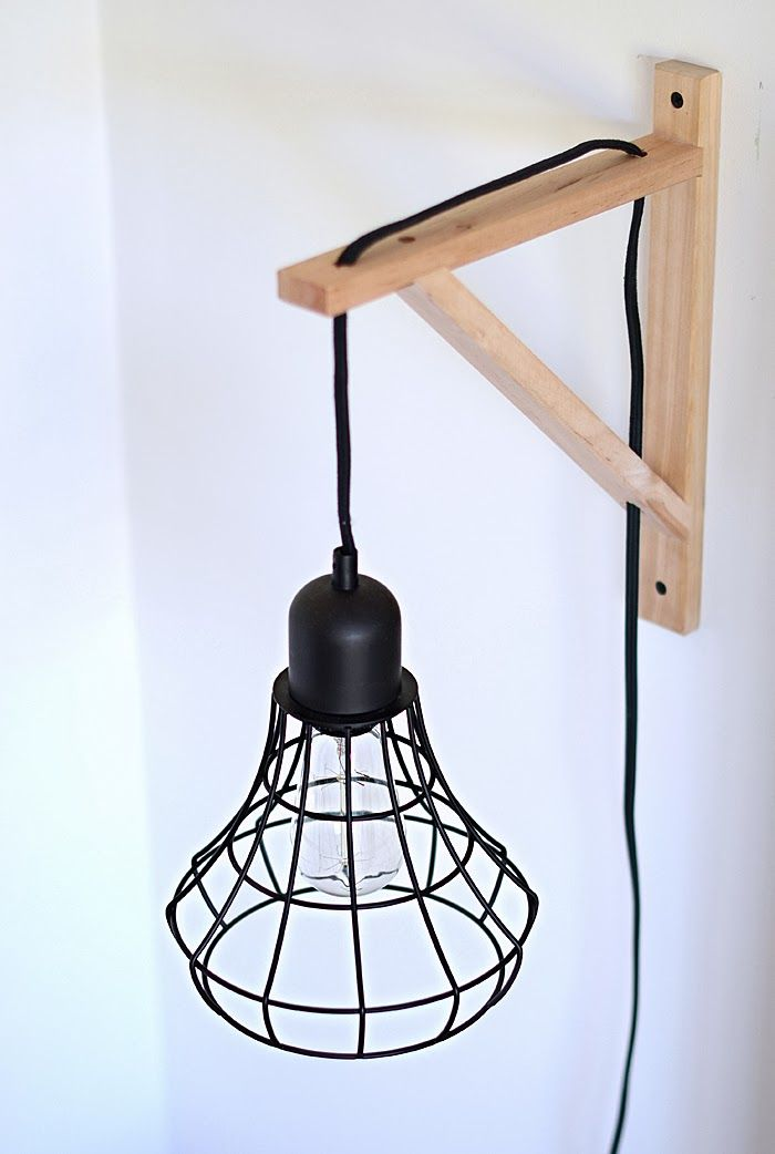 DIY: Cage Light Sconces  Use it by the couch with wrought iron instead of wood?