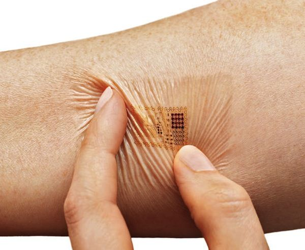 """The 'Biostamp' is a clever adhesive device that is thinner than a band-aid and the size of two postage stamps, which can be pasted onto any part of the body to """"monitor temperature, movement, heart rate and more, and transmit this data wirelessly back to patients and their clinicians""""."""