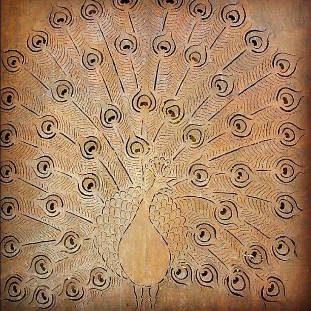 Beautiful peacock wall art at moyo Fountains