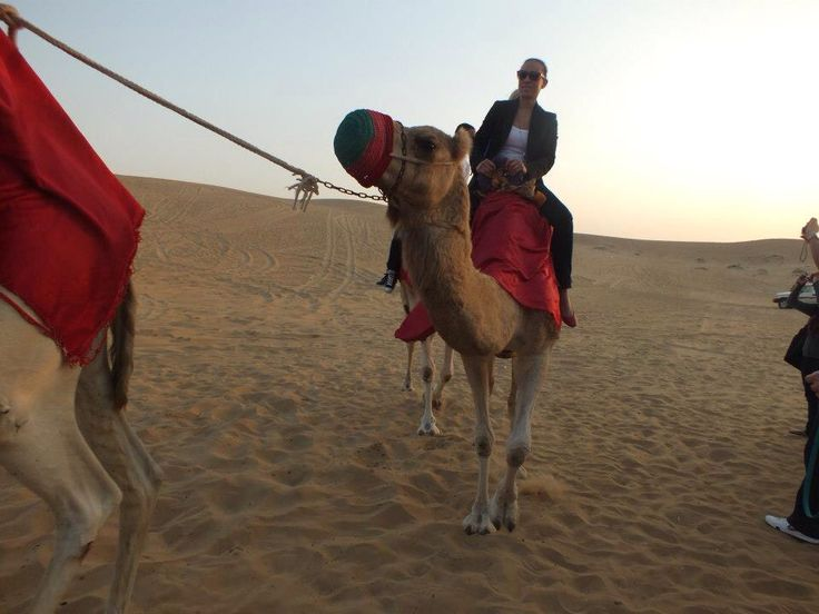 Riding a camel in Dubai desert