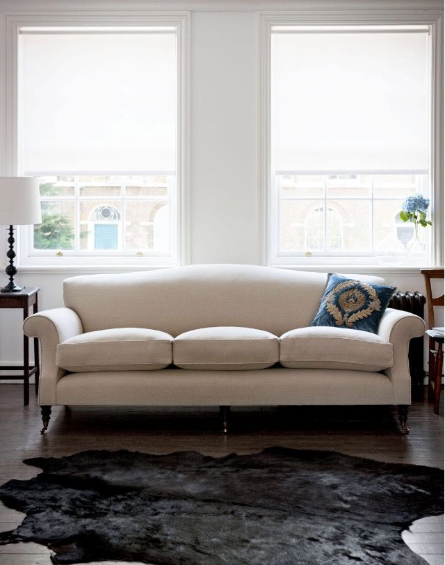 Comfortable and elegantly styled, the design of our Georgian sofa interprets the 18th Century style with a modern twist. Although the lines of this sofa are true to its Georgian antecedents, the Georgian sofa creates an exciting effect when used in a contemporary home, like this three seater in Don Donegal Linen, Oatmeal (light colour).