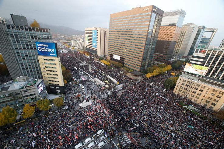"""Image result for In South Korea they come out in millions to force their president to resign over corruption People are saying """"African youths must make revolutions in their nations to restructure their political systems and remake new leadership that will put Africa on the track."""