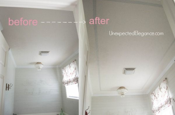 Painting strip on ceiling to make it appear higher. Maybe it boys bathroom?