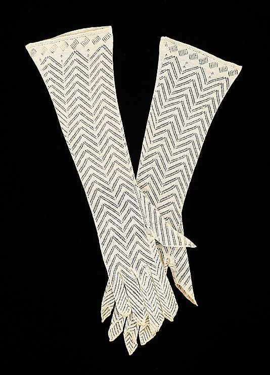 Zig-zag patterned cotton lisle evening gloves, American, 1830-35. Lisle, the knitted fabric used in these gloves, employs a highly refined cotton that has the look and softness of silk. This allows for the creation of an intricate pattern such as the zig zag example here. The open finger tips are an unusual feature that adds to their interest.