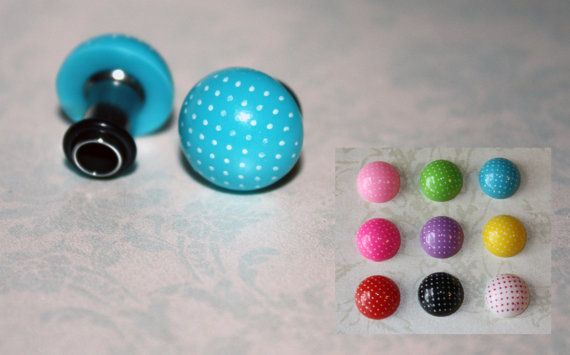 "Vintage style polka dot stainless steel plugs for gauged stretched ears Size: 14g,12g,10g,8g,6g, 4g, 2g, 0g, 00g, 7/16"". $16,50, via Etsy."