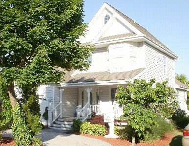 Rehoboth Beach house rental - Victorian facade w lush landscaping welcomes you!