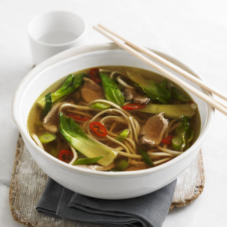 Duck and noodle soup. An Asian style broth with chilli and pak choi