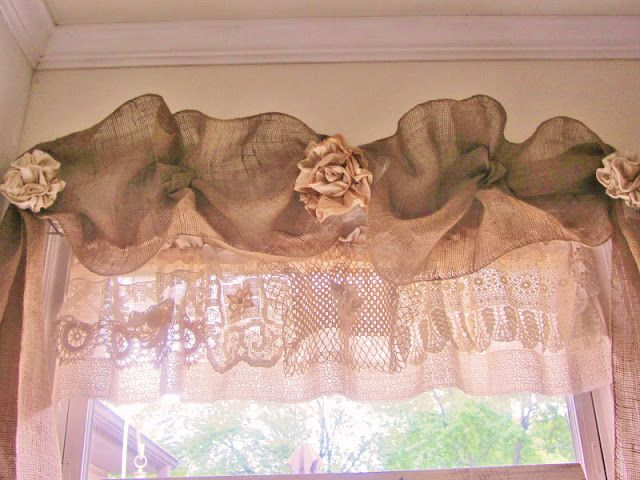 My window treatment was just some bunched burlap and I used some old vintage lace for the under valance.  Cute little fabric flowers to add some bling. Used a staple gun and it framed the window nicely and did not need curtain hardware.