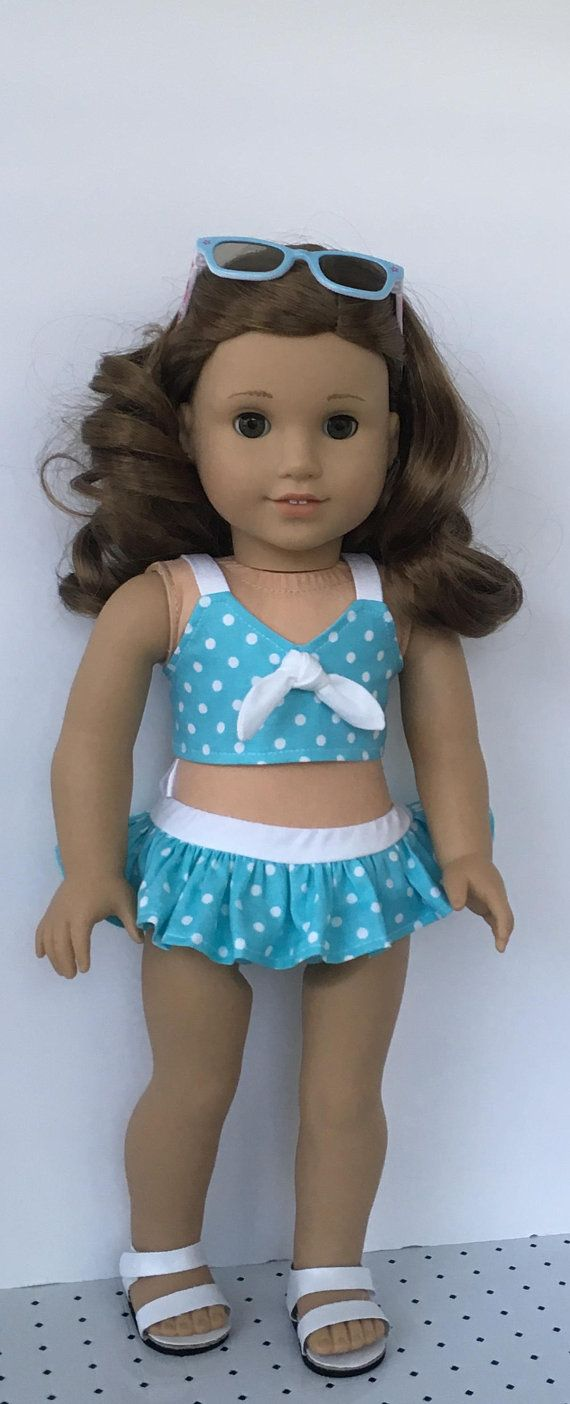 A summer bathing suit for your doll. This two piece bathing suit is made from a cotton fabric. The top is lined and has white straps. A white tie is sewn to the front and the top closes in back with Velcro. The bottoms have a elastic at the waist for easy dressing. Bottoms have