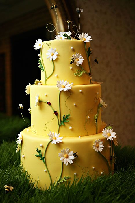 Bumblebees - For their mid-summer nuptials, Eve and Rick brought the summer into their reception with this sweet little Daisy Cake.  They didn't even mind when a crew of frosting bumblebees, lady bugs, and caterpillars crashed the reception!  Photo Credit:  Red Ribbon Studio