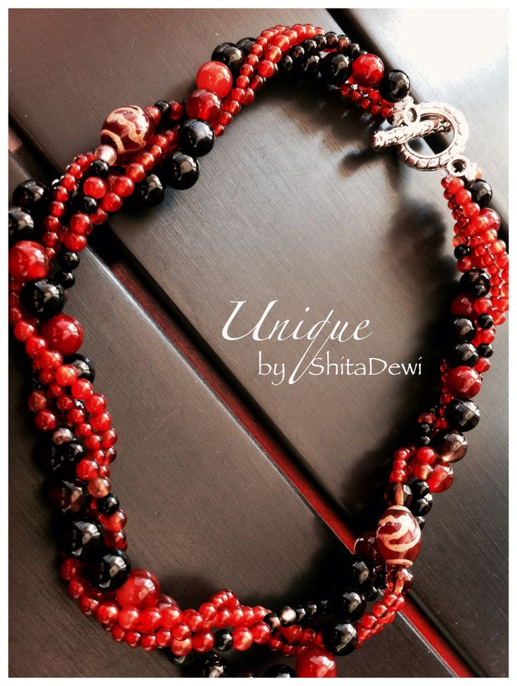 Uniquely handmade from 2 string of Red Agate (rd 3&4mm) 2 string of Black Red Agate (rd 4&8mm) & 2pcs of Chinese Dzi beads Code #BO-02, 40cm length    A symbol of fire Stands for bravery, self confident, and burning passion   IDR 275.000 include a Batik jewelry box Custom order contact : uniquely.handmade168@gmail.com