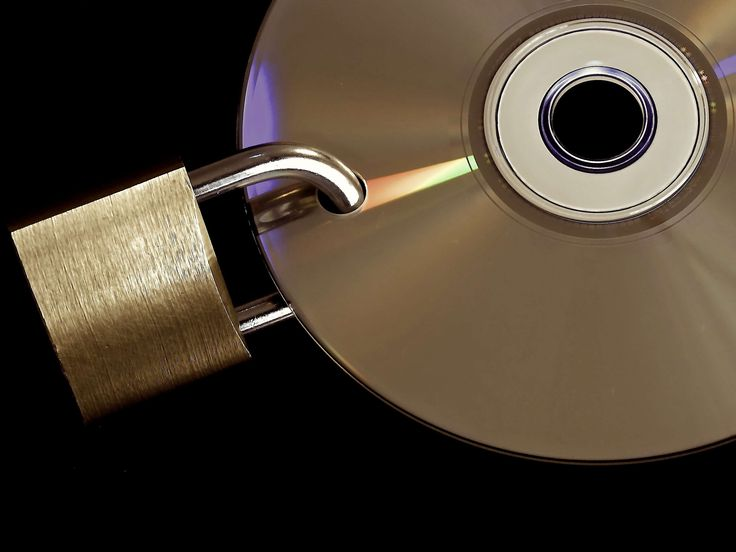 #access data #backed up #backup #castle #cd #closed #complete #computer #data backup #data security #data slice #digital #dvd #encrypted #golden #metal #padlock #password #privacy policy #security #shiny #to #u lock