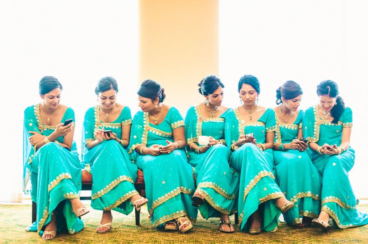 Indian wedding Raleigh, NC with bridesmaids on iphones