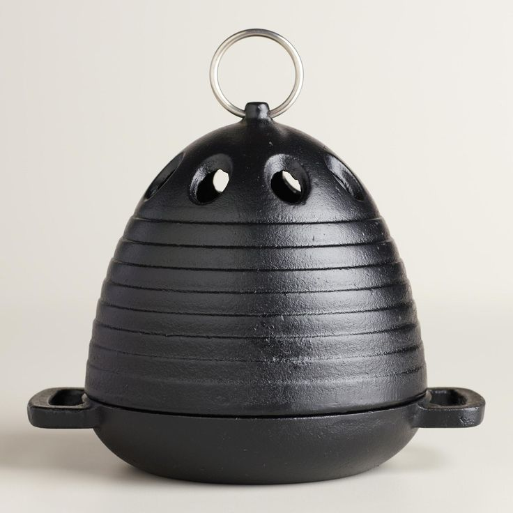 Roast delicious garlic to spice up entrees and sides with our garlic roaster. The cast iron roaster works in the oven or on the grill, drawing out the best flavors. www.worldmarket.com #CelebrateOutdoors