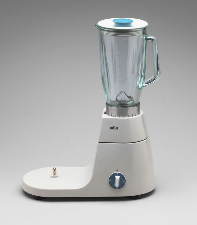 Braun AG's Multipurpose Kitchen Machine (shown here in blender configuration) was launched in 1957 as the one-stop cooking and baking appliance (the KitchenAid mixer of mid-century). The enameled metal and plastic machine featured blending, mixing, whisking, and chopping features among others.  Courtesy of Digital Image © MoMA, N.Y..