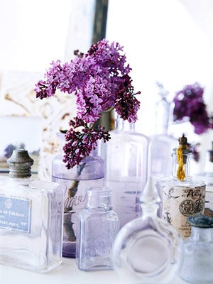 Vases look charming with or without flowers. These antique perfume bottles are perfect for a blossom or two. Select flowers that might grow in the cottage garden, such as lilacs, roses, and daisies.