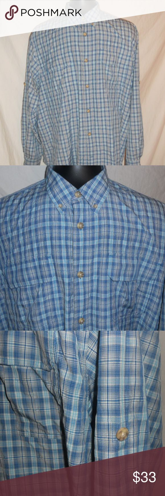 """Men's Duluth Trading Company Dress Shirt Size 3XL Men's Duluth Trading Company Dress Shirt Blue Plaid Size 3XL. Shirt has 2 breast pockets with Velcro closure and also has a button half way up the sleeve so when you roll your sleeves you can secure them to keep them from falling down. Shirt is in excellent condition with no damage and minimal wear.   Measurements  Chest - 29"""" flat  Length - 33"""" Arm Length - 26"""" Duluth Trading Co. Shirts Dress Shirts"""