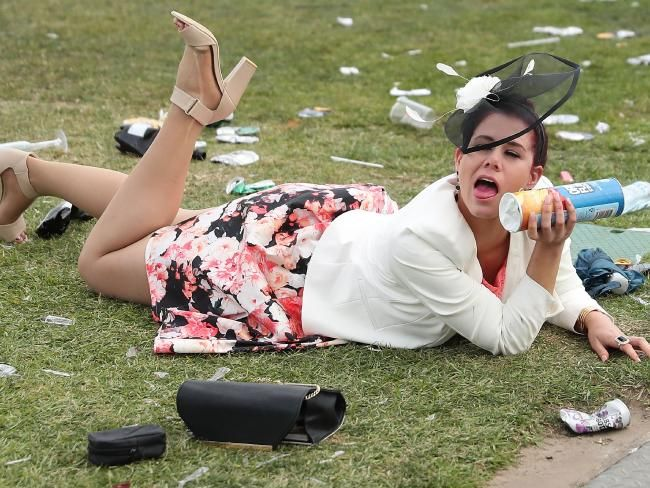A racegoers falls over following 2016 Melbourne Cup Day. Picture: Scott Barbour/Getty Images