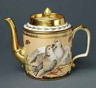 Teapot with doves and golden highlights