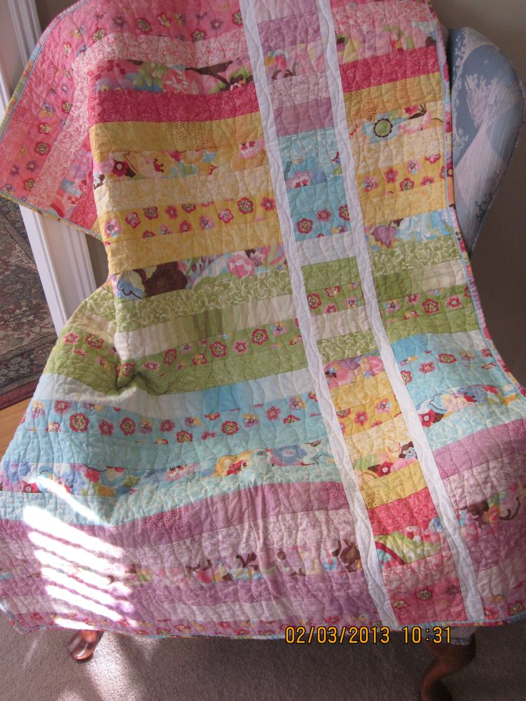 Baby quilt made with a jelly roll using strip and flip pattern by Cluck Cluck Sew.