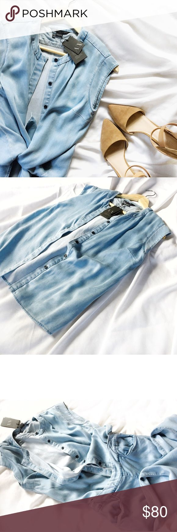 ARMANI Soft Chambray Style Cap Sleeve Blouse Authentic. New! Super soft & luxurious, looks like denim &feels like you're wearing a cloud! Tagged size S, oversized style so can fit S-M. *I personally style all pics, No modeling* NO TRADES EVER!!! Pants separate: Get the entire outfit in my closet! Bundle & save even more✅ A/X Armani Exchange Tops Button Down Shirts