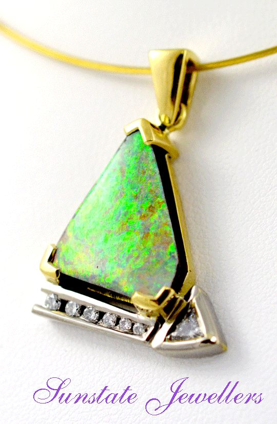 Boulder opal from Queensland's Alaric mine in 18ct yellow gold set with diamonds