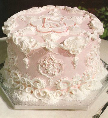 The skilled art of piping. Ivory on pale pink. So beautiful!