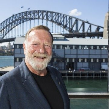 Australian actor Jack Thompson poses for a photograph with the Sydney Harbour Bridge in the background