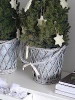 small Christmas trees in cute baskets