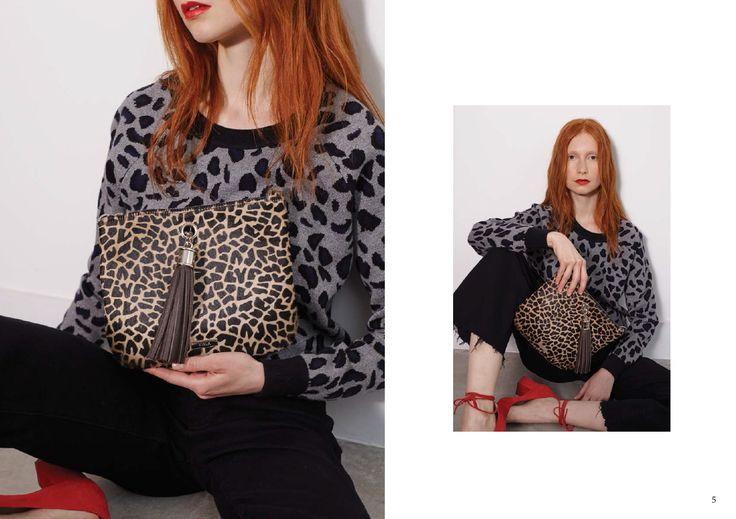 VVA clutch bag in giraffe print  http://www.vva.co.uk/products/ivy-giraffe-print