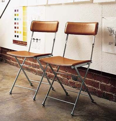 Lina Leather Folding Chair awesome for small apartments.  Obviously would need a different color.