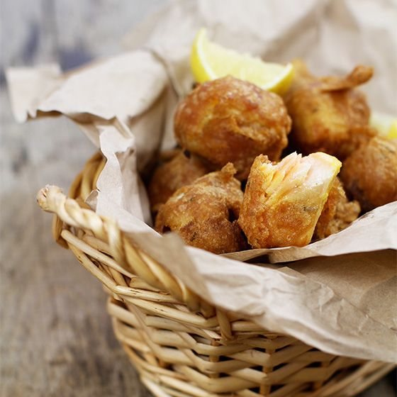 Fish Pakora White fish marinated in lime, ginger and garlic, coated in a spiced gram flour batter & fried