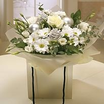 Snow White - This Snow White bouquet, is simple yet stunning with a crisp edge from the mix of cream Roses, Carnations, Lisianthus with Ruscus stems and sweet Eucalyptus, a Flower Heaven favourite.