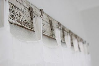 hooks on wood plank for hanging curtains, Christmas stockings, shower curtain, etc.  Why not?