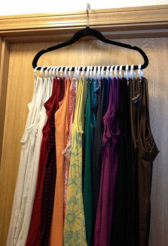 DIY Tank Top Closet Organizer - Made with a clothes hanger and shower rings - Much neater than folding tank tops in a drawer!