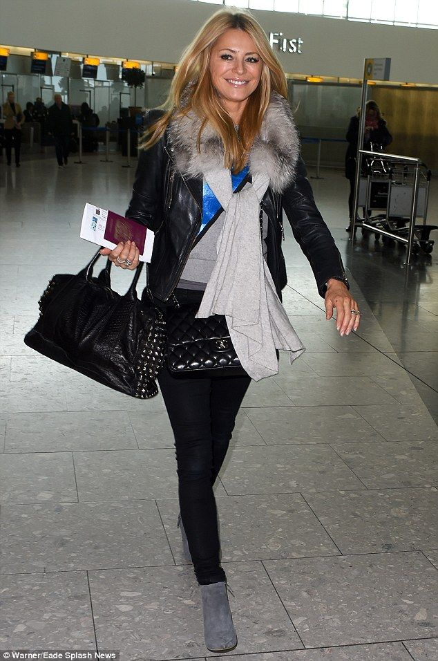 Perfect 10: Tess Daly, 46,  looked fabulous as she arrived at Heathrow airport rocking her...