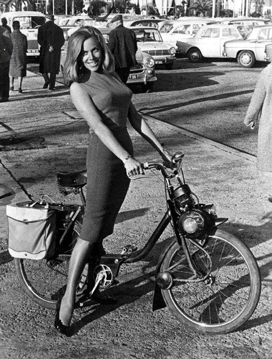 Honor Blackman on motorized bicycle, 1965 http://creepingirrelevance.tumblr.com/#james bond, motorcycle, pencil skirt, pussy galore