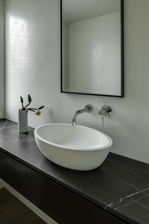 Sleek Modern Bathroom With Floating Sink Vanity Topped
