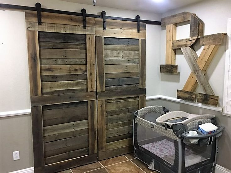 Every parent wishes to decorate their baby's nursery in the most adorably perfect manner. Making use of pallet wood to make a cupboard for the baby and to write initials of baby's name is a cool idea.