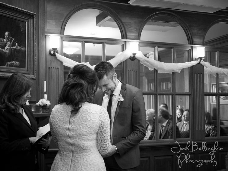 An Intimate wedding ceremony at the PIllar and Post. Gorgeous smiles from the bride and groom at the alter. Black and White Wedding Photography. @vintagehotels  #JoshBellinghamPhotography www.joshbellingham.com