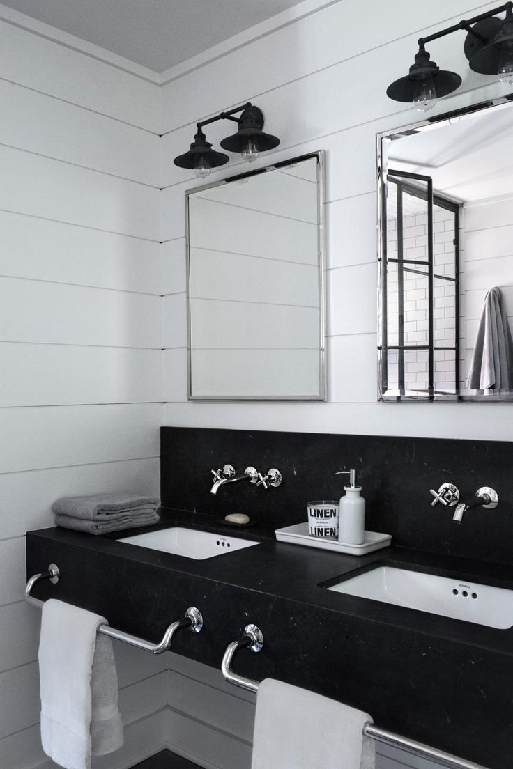 Google chrome theme infinite - Matte Black Barn Style Sconces Hang Above Polished Nickel Mirrors In This Country Bathroom With Whitewashed