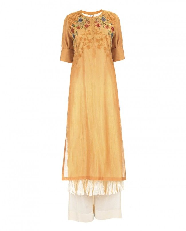 PRATIMA PANDEY | Ochre yellow kurta with floral embroidery, sequins and beads work adorning the bodice. Round neckline with button placket. Roll over sleeves. Wash Care: Dry clean onlyMatching sleeveless slip and churidar leggings included
