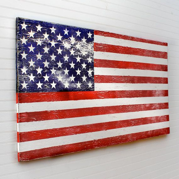 Our wooden American Flag art is all handcrafted. With its stars and stripes, it makes the perfect patriotic statement.    This painted American