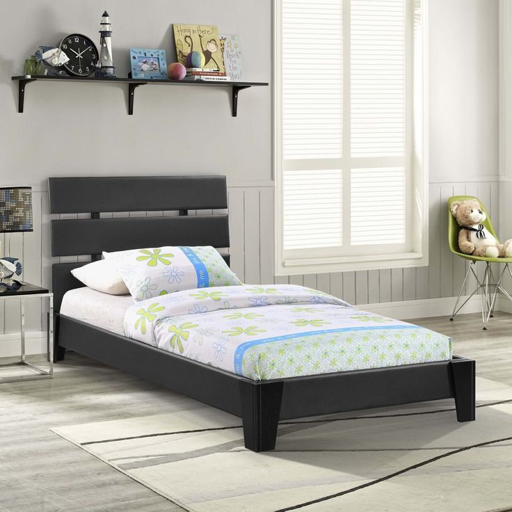 Zoe Twin Vinyl Bed, Black - Wholesale DescriptionThe craftsman's artistry creates a look that seamlessly blends with its surroundings. A triple slatted headboard and bold lines unite to present an eclectic piece filled with flair. Zoe's durable matte coating and sturdy wooden legs finish off a platform bed to animate your dreams. The Zoe Platform Twin Bed comes with foot glides to prevent floor scratching and does not require a box spring. Twin mattress not included. Set Includes: One - Zoe…