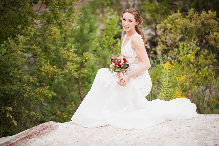 Bridal bouquet in autumn colours. Used flowers: Dahlia, Wax flower, Viburnum berries, Astilbe, Love Pearl rose and Eucalyptus. Designed by Floristika Klára Uhlířová Brno.