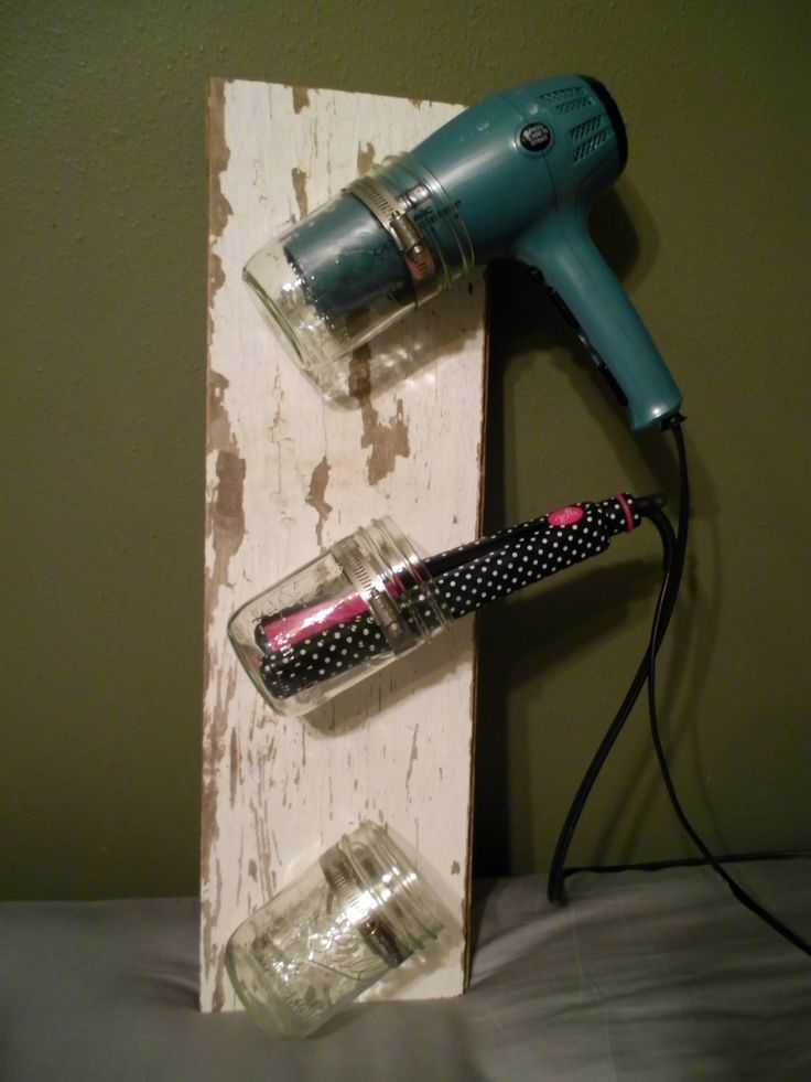 Barn board, hose clamps, and mason jars.  Thousands of uses and designs.  Tilted my jars diagonally and using to hold my hair dryer and straighteners.