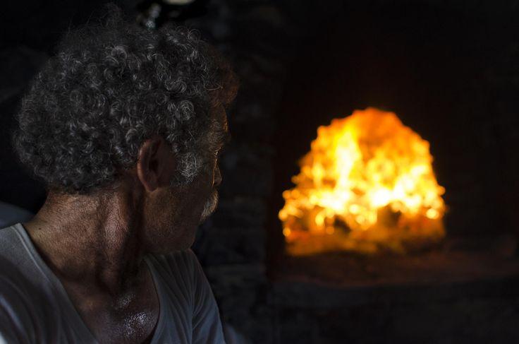 """""""ο Ψήστης"""". A grill man, during the Easter 2013, at Amorgos island, Greece."""