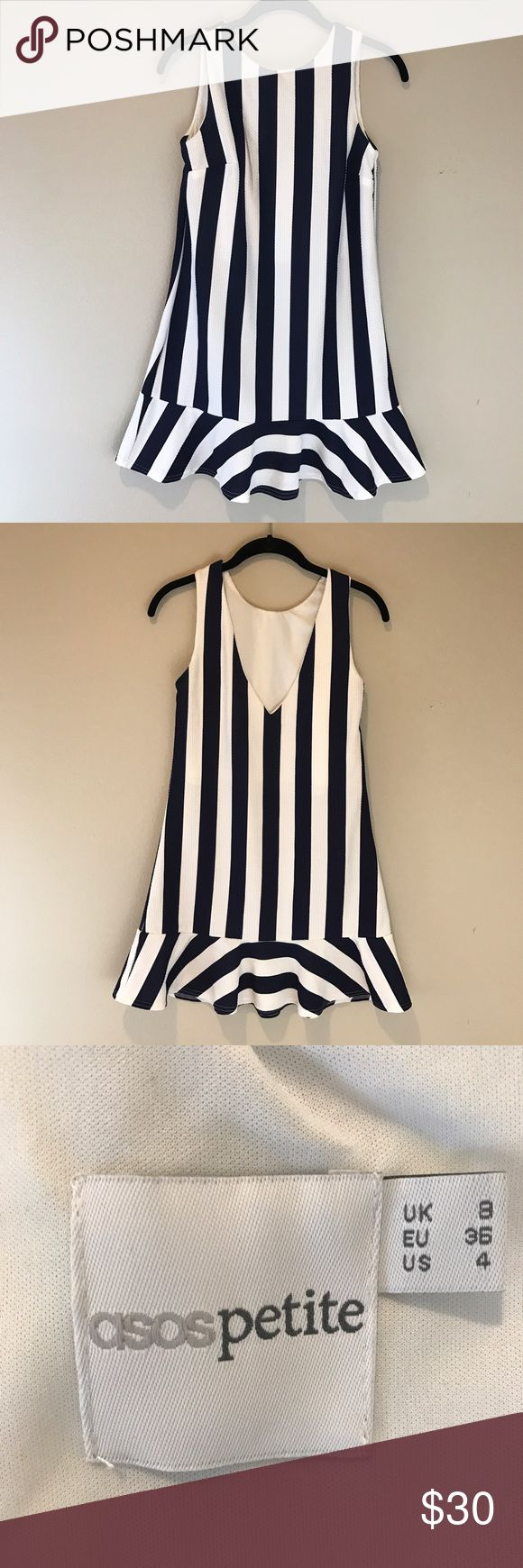 ASOS Striped Peplum Tunic Dress This can be worn as a Tunic or short dress. The Peplum skirt gives this a flirty fit! Nautical stripes in navy and white keep it from looking too girly. It's perfect! **Sizing is Petite** ASOS Dresses