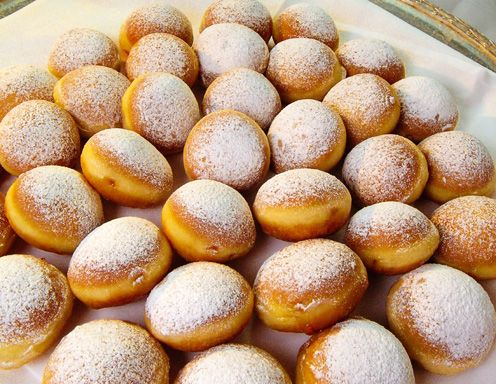 The origin of a fritter called Krapfen probably goes back to the middle ages in Central Europe. A recipe from 1531 has you mix in honey and wine as well as the usual eggs, flour and yeast. These early recipes seem to have been unfilled. They may have resembled honey-dipped Levantive fritters or, for that matter, the fritelle di Chanukà of Venice's ghetto.