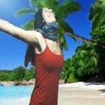 Minor delighted girl taking pleasure in her adolescence on the seashore